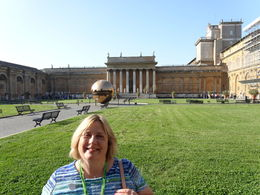 The beautiful vatican courtyard, with the and quot;Sfera con Sfera and quot;, translated as and quot;Sphere within a Sphere and quot; in the background. We were very surprise when our guide walked ... , Kristin L - May 2014