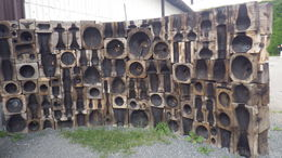 this is a small semi wall of old wooden molds outside the factory , traveling - September 2015
