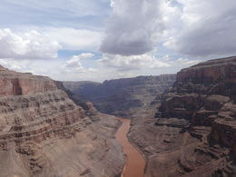 Family in helicopter photographing the Canyon. , Jerome K - July 2014