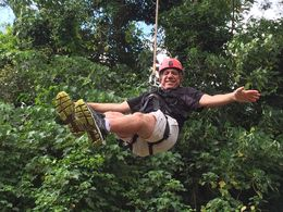 Breezing down a zipline hand free. , Elissa S - June 2016