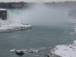 Looking up from the American Falls to Horseshoe falls. See the ice in the river., Judith S - April 2008