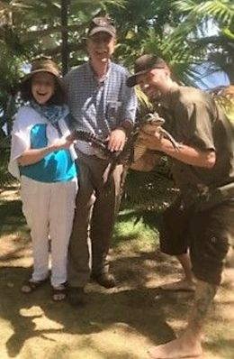 Tom and Lynda enjoy a moment with an alligator held by his trainer at Jungle Queen's private island, April 2016! , Tom B - May 2016