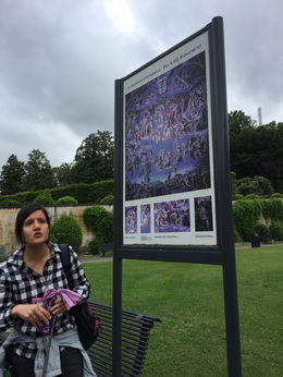 Okay, I realize she may look angry, but it's just a poor photo. This is our guide describing what we're about to see in the Sistine Chapel before we go inside to join the hoards. Very knowledgeable..., Kristine V - May 2016
