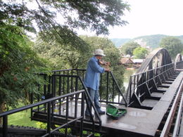 Fiddler playing music from the film on the Bridge on the River Kwai. , marilyn f - July 2011