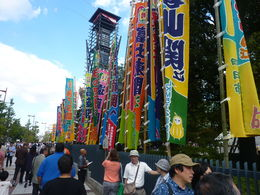 This is outside the Kokugikan Stadium as we arrived, there were a lot of people waiting around outside to see their favourite Sumos. It was very colourful with lots of market food stalls as well. , Leanne M - October 2013