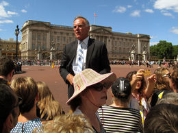 Here's our tour guide David leading our group to view the changing of the guard in front of Buckingham Palace. It took some doing but we made it! , Julie L - July 2014
