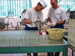 2 workers, at the Confiserie Florian, pouring fresh rose jam., Melissa S - June 2010