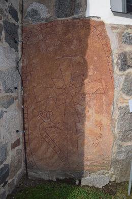 Sandstone rune in the wall of a church near Uppsala , Daniel H - October 2014