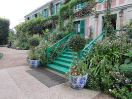 Trellises covering the front of the pink house with green shutters. , Elizabeth R - December 2017