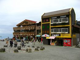 Some buildings at the 5th station. You can also see the peak of Fuji from here., David F - June 2009