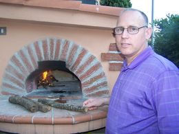 Cooking Pizza in a real brick oven. , William P - June 2015