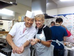 Me and our Sushi Chef hand rolling sushi! , Mary M - August 2014