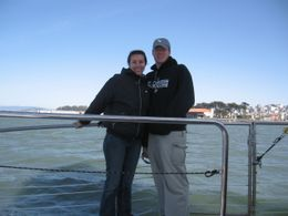 Standing on the side of the cruise boat to get a good picture of us with San Francisco in the background., Diana B - June 2008