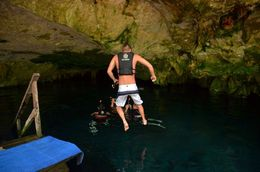 My husband jumping into the Cenote. , Michelle M - June 2016