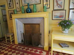 Blue and white tiles on the fireplace are repeated in the kitchen. , Elizabeth R - December 2017