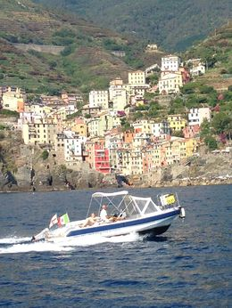 A beautiful view of one of the towns in Cinque Terra from the boat ride. , Jim F - July 2015
