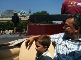Grand Palais in background. This is a large street. The ride also travelled down many small, quiet streets. As you ride, everyone turns to look at the carriage, and almost everyone smiles. Their ... , Christopher D - August 2010