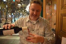 Ryan pours the wine with the Champs Élysées in the background. - January 2014