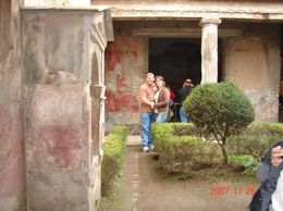 Standing in the mist of a garden in one of the houses, we toured with the group. - December 2007
