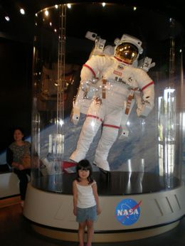Posing with miniature astronaut in Kennedy Space Center Shop., Ida Pratignjo L - October 2008