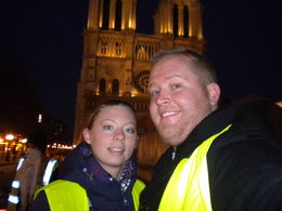 This is us in front of Notre Damn, beautifully lit, and an amzing tour. , Victoria H - April 2013