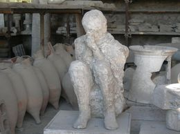 This is a plaster caste of a person obviously trying to cover his nose and mouth to save himself from asphyxiation during the eruption. The plaster caste came from an archaeological technique of ... , Lyn C - October 2008