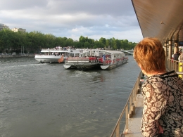 Awaiting the boarding for the Seine River Cruise under the shadow of the Eiffel Tower, John C - June 2010