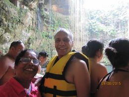 Me with life guard jacket and my wife with many other tourists at Cenote. , Hemant C S - September 2015
