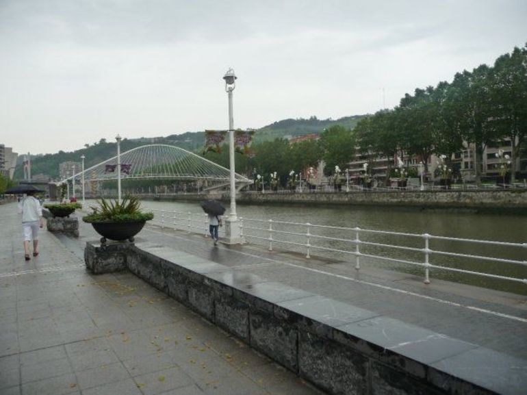 View along the waterfront with the White Bridge - Bilbao