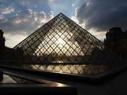 Seeing how the setting sun looks through the largest of the glass pyramids outside the Louvre., Dorothy M - July 2010