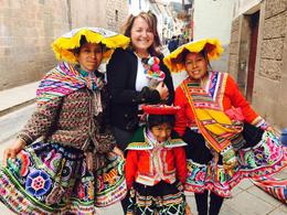 Holding a lamb with some of the locals in traditional dress in Cusco! , Darcy S - December 2016