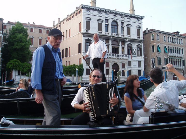 A Songster and Musician on a Gondola Ride in Venice - Venice