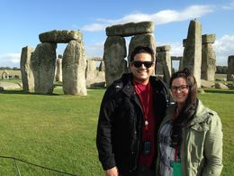 My husband and I in front of Stonehenge on the Windsor Castle, Stonehenge, and Oxford tour. , Heather P - October 2014