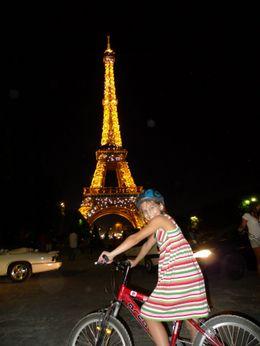 Sophie biking by the Eiffel Tower - August 2009, Scott C - August 2009