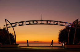 Welcome sign in the heart of Surfers Paradise, the holiday capital of the Gold Coast, Queensland Australia with beach in background. - May 2011