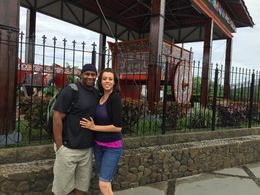 Amorette and Raheem standing in front of the giant ox cart, the national symbol of Costa Rica. , radio - June 2015