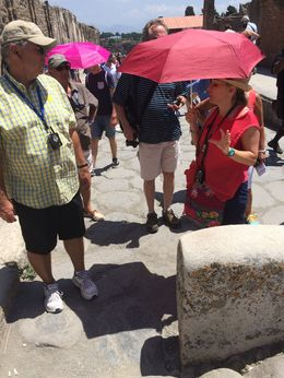 Maria Luisa explaining the street barriers to my husband in Pompeii , Shawn H - June 2015