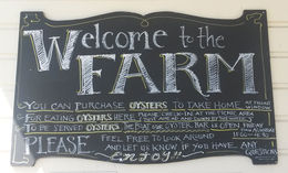 The welcome sign at Hog Island Oyster Co., Point Reyes Station, Emily G - April 2015