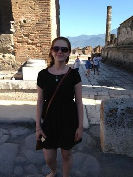 Katie standing in Pompeii marketplace , Danita G - July 2013