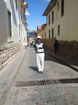 Dan on our small Cusco street , Donna C - August 2014