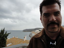 Eric on our way into Cadaques for a wonderful lunch...captured just before the rain began to fall... Didn't take away from the beauty of this city, a highlight of the tour! , Ellyn C - February 2011