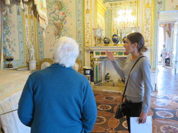 Virginia looks at exhibit in Pavlovsk Palace with guide explaining it , Rodger G - May 2016
