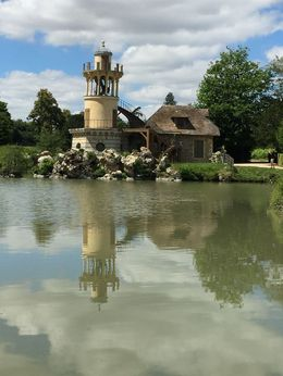 Wind Mill and it's beautiful reflection from the Petit Trianon. , Arianne M - August 2016