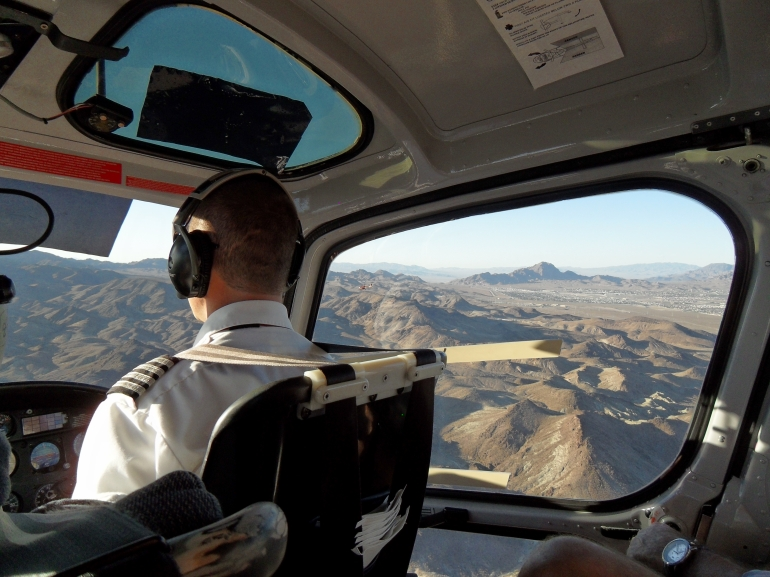 Helicopter pilot and view through the side door - Las Vegas