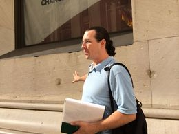 Tom points out the damage left from the Wall Street bombing of 16 September 1920--almost exactly 94 years from the day of our tour. , Steven S - September 2014