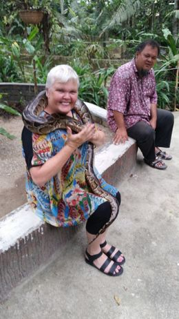 Greer holding a snake at the private zoo with Ai, our tour guide. , G D - February 2015