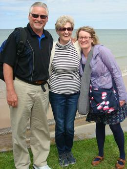Family photo at Omaha Beach as Mat, our guide, makes us all laugh , Erin - June 2017