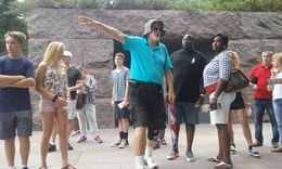 This is our tour guide, John A, explaining the different statues at the Roosevelt monument. , Audrey C - July 2016