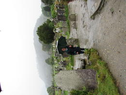 Our driver John, waiting in the rain for us at St. Kevin's Monastery. , Kevin P - August 2017