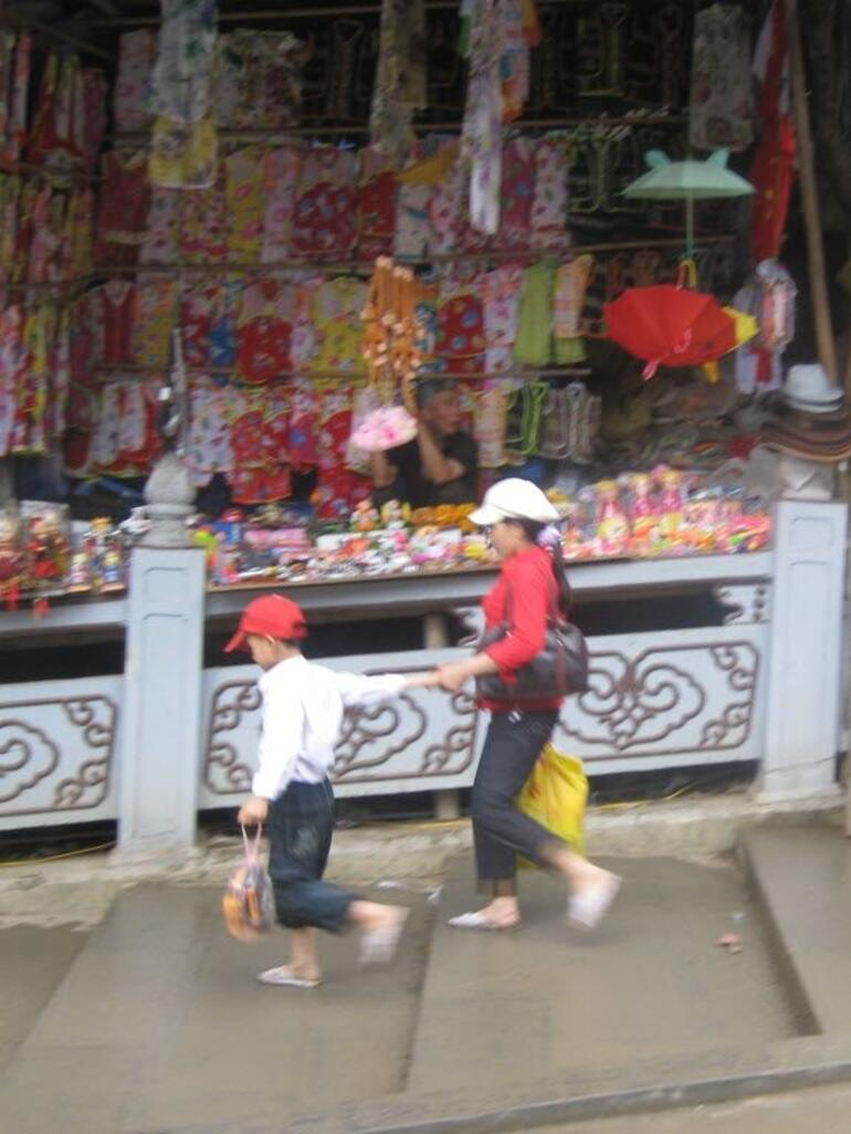 Walking past shops - Hanoi